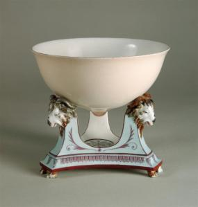 Milk Bowl (Breast Bowl), from the Service for the Dairy, together with tripod base for Queen Marie Antoinette. 1788. Sèvres Porcelain Manufactory. Painted by Fumez, after design by Jean-Jacques Lagrené and Louis-Simon Boizot. Photo: M. Beck-Coppola (Musée National de la Céramique, Sèvres).